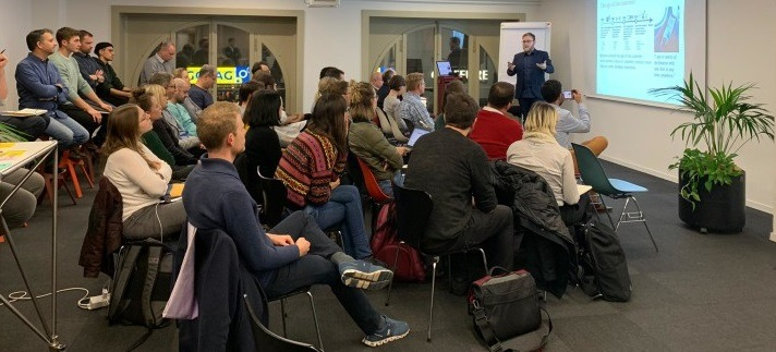 crowd at service design event participating in a presentation